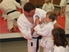 Sensei Congratulating Kids Karate Student in Ashburn VA