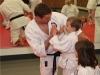 Sensei Congratulating Kids Karate Student in Ashburn VA